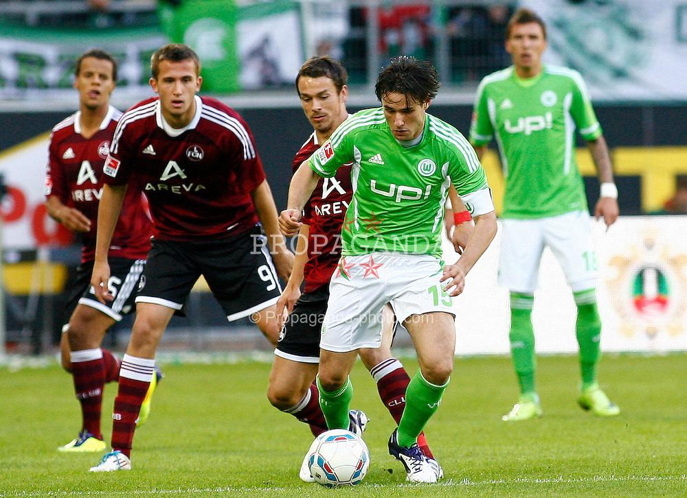 15.10.2011,Volkswagen Arena, Wolfsburg, GER, 1.FBL,VfL Wolfsburg vs 1. FC Nuernberg , im Bild  Christian Traesch (Wolfsburg #15) und  Tomas Pekhart (Nuernberg #9) .// during the match from GER, 1.FBL, VfL Wolfsburg vs 1. FC Nuernberg  on 2011/10/15, Volkswagen Arena, Wolfsburg, Germany..EXPA Pictures © 2011, PhotoCredit: EXPA/ nph/  Schrader       ****** out of GER / CRO  / BEL ******