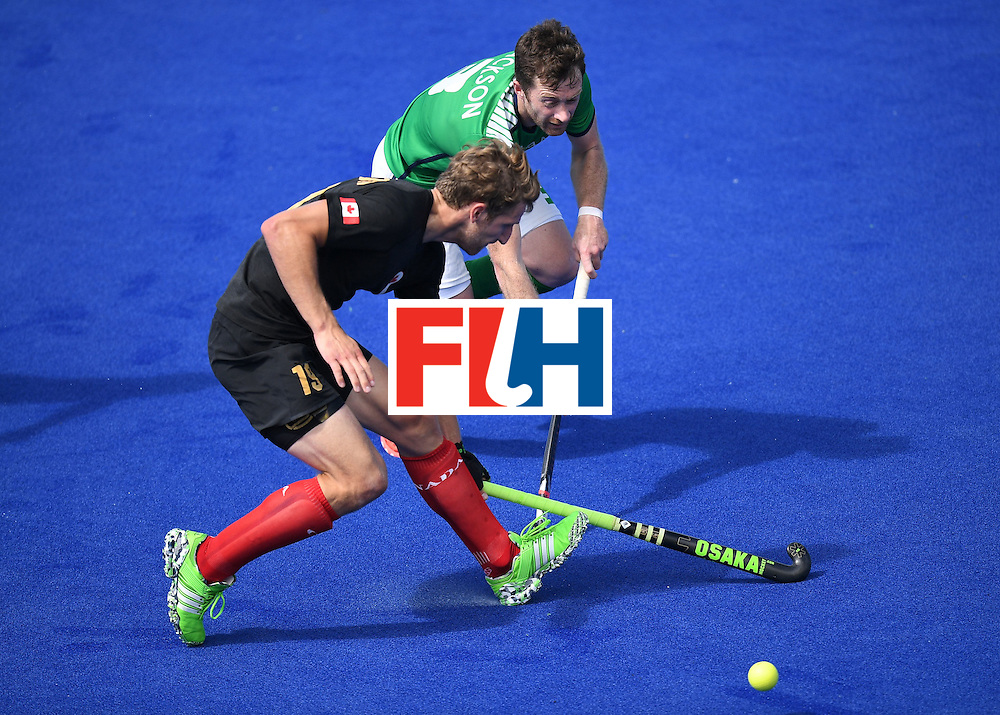 Canada's Mark Pearson (L) vies for the ball with Ireland's John Jackson during the men's field hockey Ireland vs Canada match of the Rio 2016 Olympics Games at the Olympic Hockey Centre in Rio de Janeiro on August, 11 2016. / AFP / MANAN VATSYAYANA        (Photo credit should read MANAN VATSYAYANA/AFP/Getty Images)