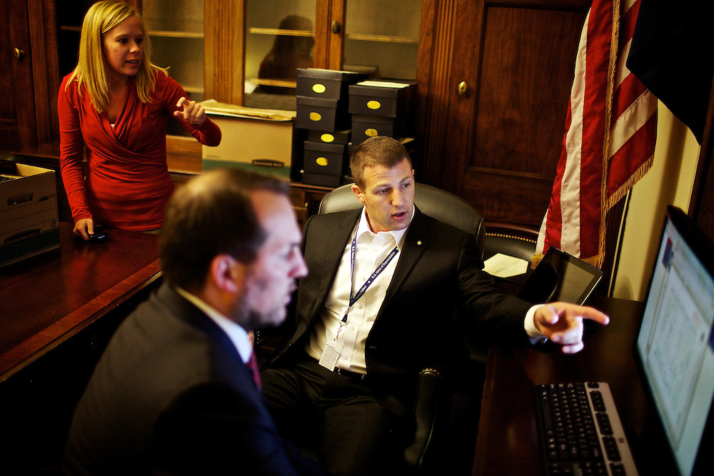 Congressman-elect Markwayne Mullin, right, from Oklahoma's 2nd District, makes decisions about his future office with his advisor Trebor Worthen, center, and another congress staff member, left, in the Longworth House Office Building in Washington, DC on Nov. 29, 2012.