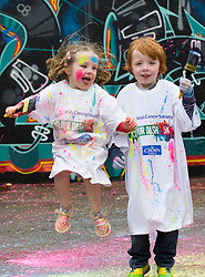 Repro Free: 12/05/2014 Dublin <br /> Douglas (5) and Alexandra Kelly (4) from Stepaside, Dublin are pictured getting colourfull as the Irish Cancer Society and Crown call on people to add some colour to their lives and sign up today to take part in the Irish Cancer Society&rsquo;s Colour Dash. Together, we won&rsquo;t give up until cancer does. To register for your place CallSave our team on 1850 60 60 60 or visit www.cancer.ie 