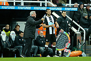 Newcastle United manager Steve Bruce issues instructions to Andy Carroll (#7) of Newcastle United as he prepares to be substituted on during the Premier League match between Newcastle United and Southampton at St. James's Park, Newcastle, England on 8 December 2019.