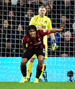 Nathan Ake (5) of AFC Bournemouth holds his calf after injuring himself after making a goal saving tackle on Mohamed Salah (11) of Liverpool during the Premier League match between Bournemouth and Liverpool at the Vitality Stadium, Bournemouth, England on 7 December 2019.