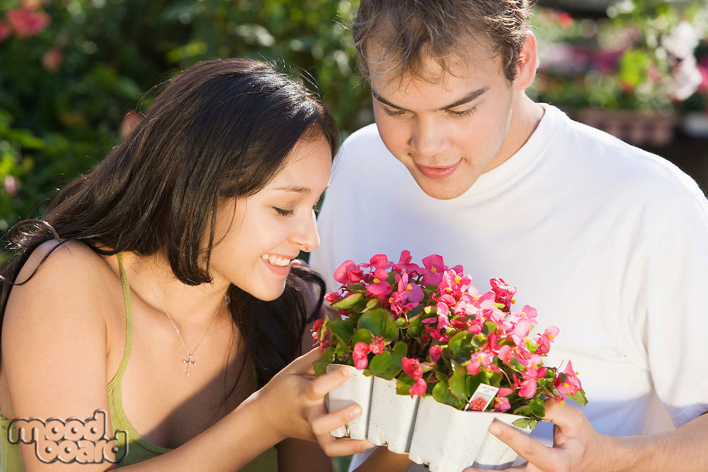 Couple Smelling Flowers