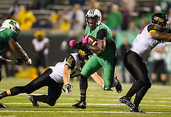 Oct 9, 2015; Huntington, WV, USA; Marshall Thundering Herd running back Remi Watson runs the ball up the middle during the second quarter against the Southern Miss Golden Eagles at Joan C. Edwards Stadium. Mandatory Credit: Ben Queen-USA TODAY Sports