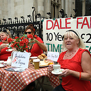 Dale Farm Travellers enjoying tea and biscuits outside.the High Court of Justice before their Hearing