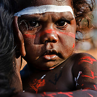 Garma Festival by photographer Cameron Herweynen<br /> Garma Festival 2016, a celebration of Yolngu culture, in Gulkaka, far north eastern Arnhem Land, Northern Territory, NT, Australia. The Top End of Australia. The Yolngu are the original Australians, from well before white European and English settlement. They are the aboriginal indigenous people of the land, called Arnhemland. Arnhemland is their own land, and the Yothu Yindi Foundation, is an aboriginal not-for-profit organisation working to preserve and nurture Yolngu Culture. The Yolngu are connected to land, their university is in their songs, the Yidaki (didgeridoo), art, designs, paintings, stories, all performed on the Bungul ground (traditional dancing sacred site) at the Garma Festival, a coming together of two cultures to better enrich the lives of all involved. Yolngu educating the Balanda (while folk) about the Yolngu ways, their traditional culture, as displayed in all areas of their lives. The Garma Festival is a powerful experience for all involved, and it&rsquo;s my joy as official photographer to the Yothu Yindi Foundation at the Garma Festival, to be invited to photograph the rich culture and heritage of the Yolngu. They are a warm beautiful people, and it&rsquo;s my joy to be part of their culture, and document it through my photography
