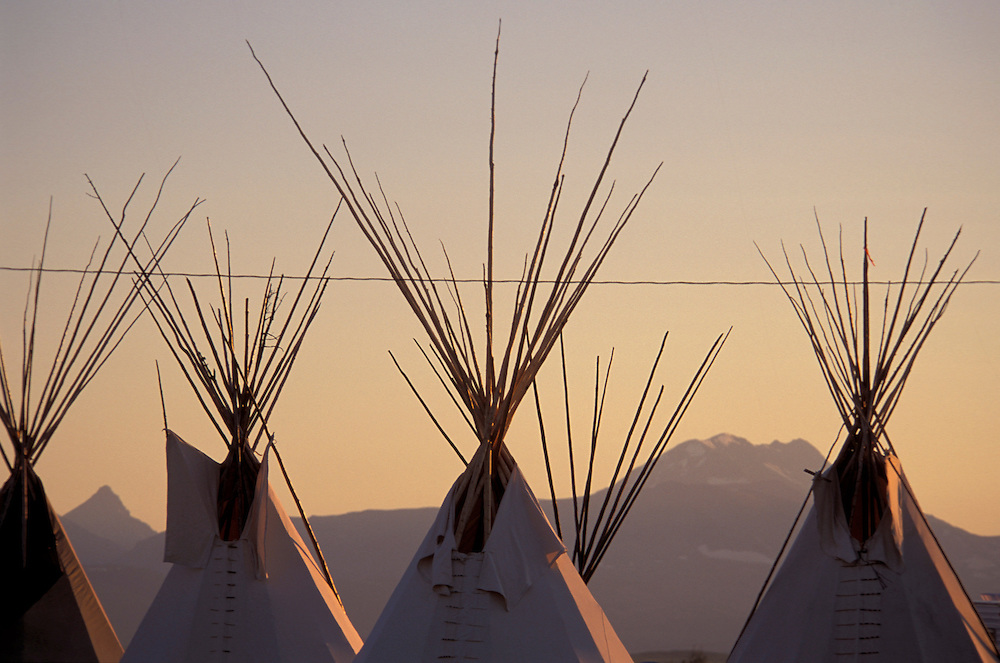 Tipi Encampment, Rocky Mountain front and Glacier National Park in background, North American Indian days, Blackfeet Indian Reservation, Browning, Montana, USA