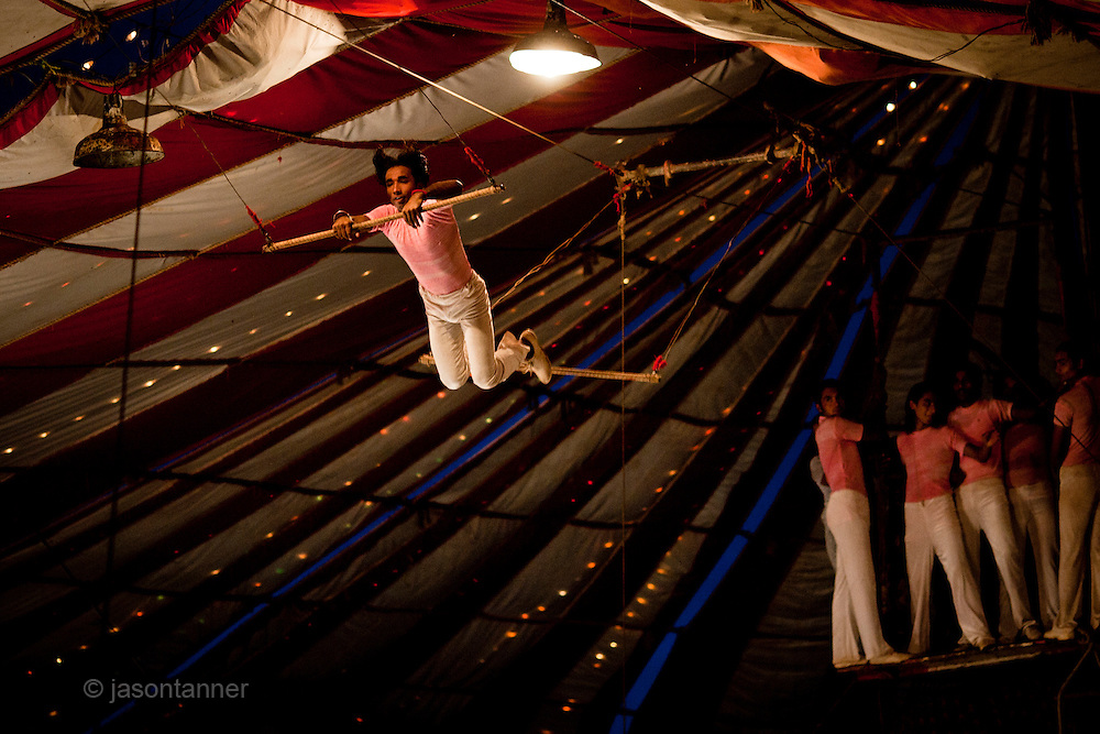 Islamabad: trapeze Performers with the Jan Baz Circus providing an evenings entertainment at Pothohari Village in Islamabad...©jtanner 2010