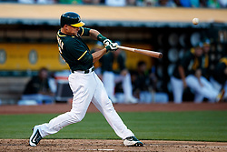 OAKLAND, CA - JULY 15:  Matt Chapman #26 of the Oakland Athletics hits a double against the Oakland Athletics during the fifth inning at the Oakland Coliseum on July 15, 2017 in Oakland, California.  The Oakland Athletics defeated the Cleveland Indians 5-3. (Photo by Jason O. Watson/Getty Images) *** Local Caption *** Matt Chapman