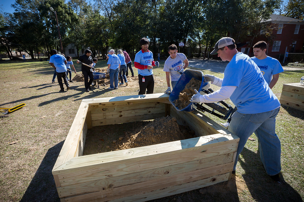 NOVEMBER, 17, 2017 - NORTH CHARLESTON, S.C. - United Way Day of Caring volunteers build three landscaping beds on the playground near the academy in North Charleston. (BNG/Stephen B. Morton)