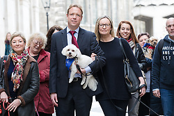 © Licensed to London News Pictures. 20/02/2017. LONDON, UK.  Gabby (Gabrielle) and Florian Kuehn with Vinnie, supporters and their dogs outside Mayor's and City of London court in London for a hearing against their property management company, Victory Place. Gabby and Florian Kuehnn from Limehouse in east London claim they were told their pet dog, a Yorkshire terrier cross, Vinnie could live in their flat when they purchased it, but the management firm, Victory Place has subsequently insisted it has has a blanket no-pets policy. The animal rescue charity, All Dogs Matter are backing the couple and says no-pet rules see thousands of pets dumped each year and the rules are particularly unfair on the elderly and vulnerable who rely on pets for support and companionship.  Photo credit: Vickie Flores/LNP