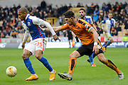 Wolverhampton Wanderers defender Danny Batth holds up Blackburn Rovers striker Simeon Jackson during the Sky Bet Championship match between Wolverhampton Wanderers and Blackburn Rovers at Molineux, Wolverhampton, England on 9 April 2016. Photo by Alan Franklin.