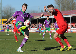 Bristol City's Aden Flint is closed down by Crawley's Sonny Bradley - Photo mandatory by-line: Dougie Allward/JMP - Mobile: 07966 386802 - 07/03/2015 - SPORT - Football - Crawley - Broadfield Stadium - Crawley Town v Bristol City - Sky Bet League One