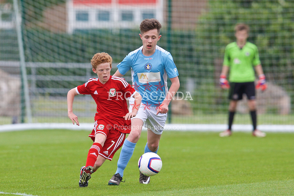 NEWPORT, WALES - Wednesday, May 27, 2015: Regional Development Boys' Lewis Clutton and South WPL Academy Boys' Eithien Davies during the Welsh Football Trust Cymru Cup 2015 at Dragon Park. (Pic by David Rawcliffe/Propaganda)