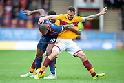 Peter Hartley (#6) of Motherwell FC tackles Uche Ikpeazu (#19) of Heart of Midlothian during the Ladbrokes Scottish Premiership match between Motherwell and Heart of Midlothian at Fir Park, Motherwell, Scotland on 15 September 2018.