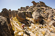 Paul Maree winds his way through towers of rock during stage 2 of the 2013 Absa Cape Epic Mountain Bike stage race from Citrusdal to Saronsberg Wine Estate in Tulbagh, South Africa on the 19 March 2013<br /> <br /> Photo by Greg Beadle/Cape Epic/SPORTZPICS Global sport and corporate event photography by Greg Beadle. Greg captures the energy and emotion of international events including the World Economic Forum, Tour de France, Cape Epic MTB and the Cape Town Cycle Tour