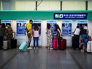 SEOUL, SOUTH KOREA: Passengers wait to buy tickets at Seoul Station, the largest train station in South Korea.   PHOTO BY JACK KURTZ