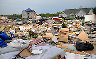 23 APRIL 2011 -- BRIDGETON, Mo. -- Family, friends, neighbors and volunteers help the rubble and finding salvageable items in the remains of their home on Beaverton Drive in Bridgeton, Mo. Saturday, April 23, 2011. The home was destroyed in an apparent tornado that struck the community Friday, April 22, 2011.  Image © copyright 2011 Sid Hastings.