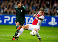 Real Madrid's  Kaka vies with Ajax Amsterdam's  Niklas Moisander during the UEFA Champions League Group D football match Ajax Amsterdam vs Real Madrid on October 3, 2012 AFP PHOTO/ ROBIN UTRECHT.