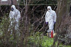 © Licensed to London News Pictures. 09/02/2016. London, UK. Police forensic officers walk past fire extinguishers near Kensington Palace in west London. A man set himself on fire and died after burning to death in the early hours of this morning near Kensington Palace. Photo credit : Vickie Flores/LNP