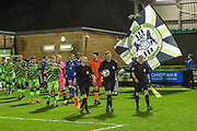 The teams enter the pitch during the EFL Sky Bet League 2 match between Forest Green Rovers and Carlisle United at the New Lawn, Forest Green, United Kingdom on 28 January 2020.