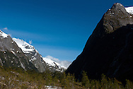 Dark shadow on the steep slopes of the glacial valley of Clinton Canyon, Milford Track, Fiordland, New Zealand