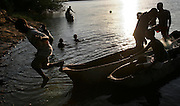 Local fisherman return to shore on a river near Mambone, Mozambique. (2005)