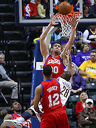 April 21, 2012; Indianapolis, IN, USA; Philadelphia 76ers center Spencer Hawes (0) goes up to defend the shot of Indiana Pacers shooting guard Leandro Barbosa (28) at Bankers Life Fieldhouse. Philadelphia defeated Indiana 109-106. Mandatory credit: Michael Hickey-US PRESSWIRE
