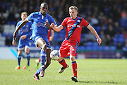 Ousmane Fane challenged by Jamie Allen during the EFL Sky Bet League 1 match between Oldham Athletic and Rochdale at Boundary Park, Oldham, England on 22 April 2017. Photo by Daniel Youngs.