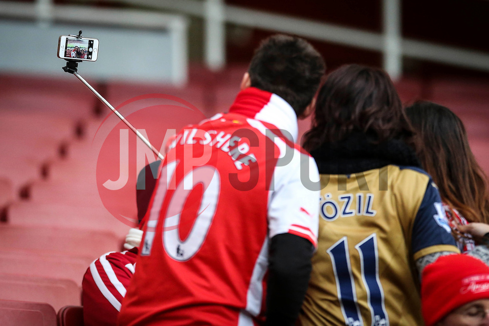 Arsenal fans take a selfie in the Emirates Stadium - Mandatory byline: Jason Brown/JMP - 07966386802 - 05/12/2015 - FOOTBALL - Emirates Stadium - London, England - Arsenal v Sunderland - Barclays Premier League