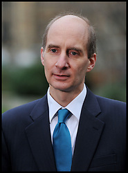 Andrew Adonis, Labour politician, giving a TV interview, he was Secretary of State for Transport between 2009-2010 hold up a High Speed Rail Arrivals card outside the House of commons in favour of the announcement  today that Phase one of high-speed rail line gets go-ahead, Tuesday January 10, 2012. Photo By Andrew Parsons/ i-Images