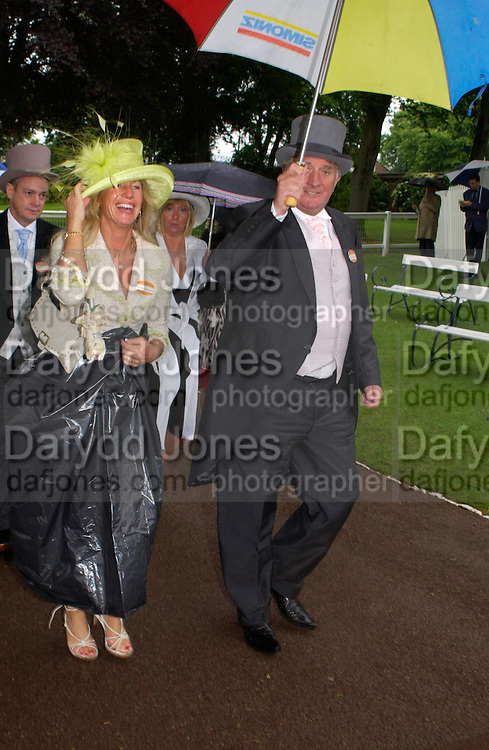 Miss Maureen Nicholson ( in bin-liner) and Brian Trubshaw. Royal Ascot Race meeting Ascot at York. Wednesday, 15 June 2005. ONE TIME USE ONLY - DO NOT ARCHIVE  © Copyright Photograph by Dafydd Jones 66 Stockwell Park Rd. London SW9 0DA Tel 020 7733 0108 www.dafjones.com