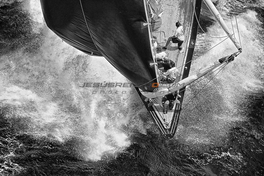 Hanuman's bow gang , rounding wind mark mark and hoisting spinnaker. SuperYachtCup 2014, LAST DAY © Jesús Renedo