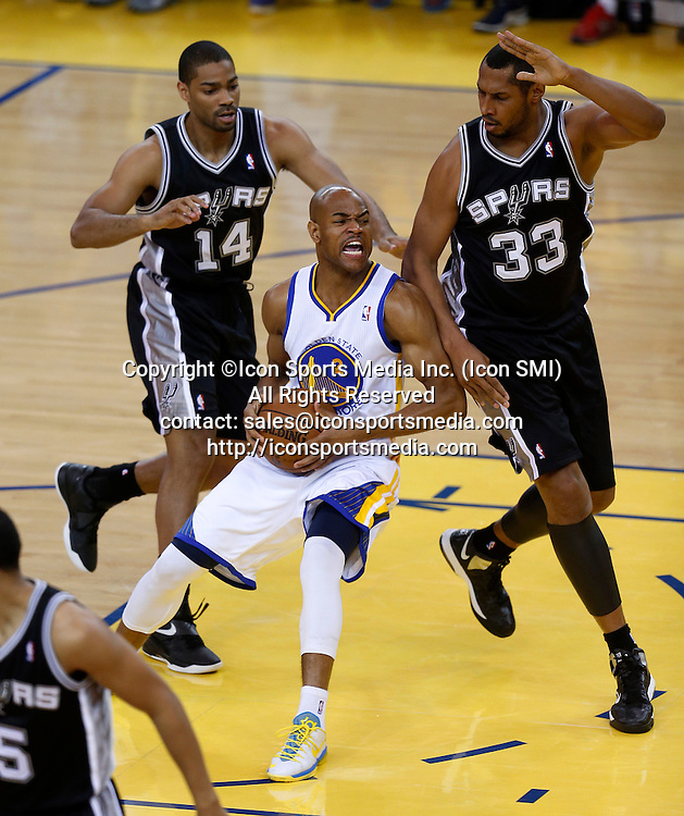 May 16, 2013 - Oakland, CA, USA - The Golden State Warriors' Jarrett Jack (2) loses control of the ball against the San Antonio Spurs' Gary Neal (14) and Boris Diaw (33) in the first quarter of Game 6 in the Western Conference semifinals at Oracle Arena in Oakland, California, on Friday, May 16, 2013