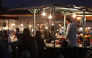 Restaurants at night in the Djemma el Fna square and marketplace, Medina, Marrakech, Morocco. Picture by Manuel Cohen