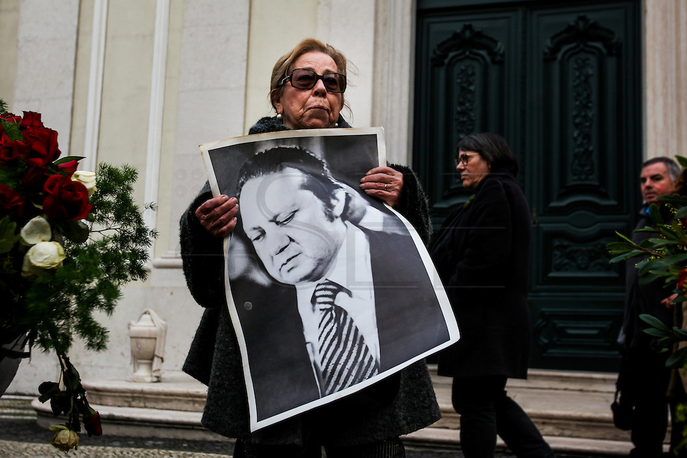 January 6, 2017. Lisbon - Portugal.<br /> Woman with a Mario Soares portrait.<br /> Funeral ceremony of Mario Soares. Ex-president of the republic of Portugal.