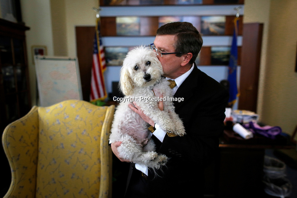 U.S. Senator Kent Conrad (D-ND) and his dog Dakota, who will no longer be fixtures at the U.S. Capitol when Conrad leaves office at the end of the term, sit for a portrait in the senator's Capitol Hill office in Washington, November 15, 2012. (Photo by Jonathan Ernst for The New York Times)