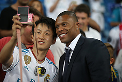 August 17, 2017 - Madrid, Spain - Former Real Madrid player Julio Baptista with a fan. Real Madrid defeated Barcelona 2-0 in the second leg of the Spanish Supercup football match at the Santiago Bernabeu stadium in Madrid, on August 16, 2017. (Credit Image: © Antonio Pozo/VW Pics via ZUMA Wire)