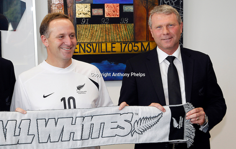 Prime Minister John Key is presented with a jersey and scarf as he is made Patron of the All Whites for the 2010 FIFA World Cup campaign, 31 March, 2010 by Chairman Frank van Hattum, Ricki Herbert and CEO Michael Glading  Photo : Anthony Phelps/PHOTOSPORT