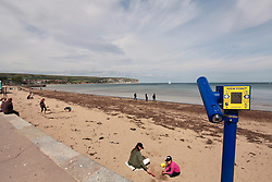Swanage Bay during Coronavirus lockdown, Dorset UK May 2020.  As restrictions are eased people are now allowed on the beaches - and to sunbathe