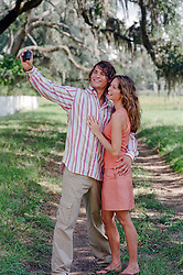 couple taking a photograph of themselves outdoors in Charleston, SC