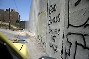 """god builds bridges not walls"" - wall separating israel with the west bank, palestine, israel"