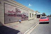 Rainbow is a small town of 600 on the western edge of the Victorian Mallee. †It's a community in decline where people have to help each other and work together just to keep the place alive. †Historic murals are a constant reminder that the town's past is richer than its present. The Victorian Mallee is a sea of earth under an ocean of sky. †Rainbow itself is surrounded by the Big Desert on one side and endless acres of grain on the other three.  The nearest large town Horsham is an hour away. †Its difficult to imagine that you might feel confined in a place like this, but by my second day in town, everyone knew who I was and why I was there. †All that space and nowhere to hide. †After a week I was thankful my stay was temporary - but I knew that for those who live there, the pot of gold lies in Rainbow.  Image © Arsineh Houspian/Falcon Photo Agency.