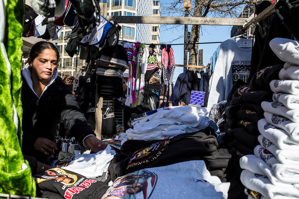 A vendor sells Inauguration-themed t-shirts on the street near the White House on Sunday, January 20, 2013 in Washington, DC.