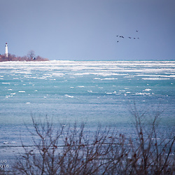 A lighthouse on icy Lake Michigan
