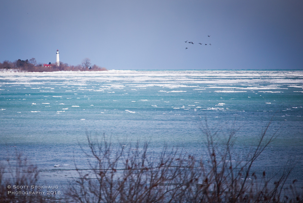 A lighthouse on icy Lake Michigan