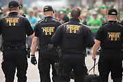 A Secret Service Agents patrol the area where Vice President Mike Pence is scheduled to watch the Savannah St. Patrick's Day parade, Saturday, March 17, 2018, in Savannah, Ga. (AP Photo/Stephen B. Morton)