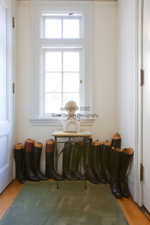 The Portland, Oregon home of Wendy Burden, author of  the memoir, Dead End Gene Pool.  The front hall entryway is decorated with 4 generations of riding boots.