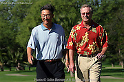 BJ Wie, the father of fifteen year old Michelle Wie, walks down the fairway with the Golf Channel's Mark Rolfing during a practice round prior to The 2005 Sony Open In Hawaii. The event was held at The Waialae Country Club in Honolulu, Hawaii.