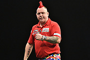 Peter Wright  wins a leg against Phil Taylor  during the Betway Premier League Darts at the Manchester Arena, Manchester, United Kingdom on 23 March 2017. Photo by Mark Pollitt.